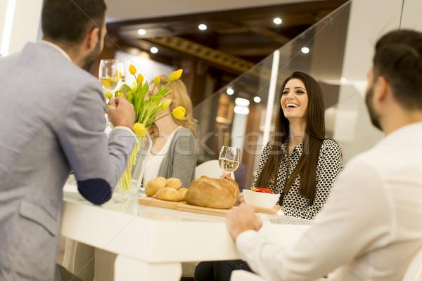 Jongeren diner witte wijn vrouwen gelukkig Stockfoto © boggy