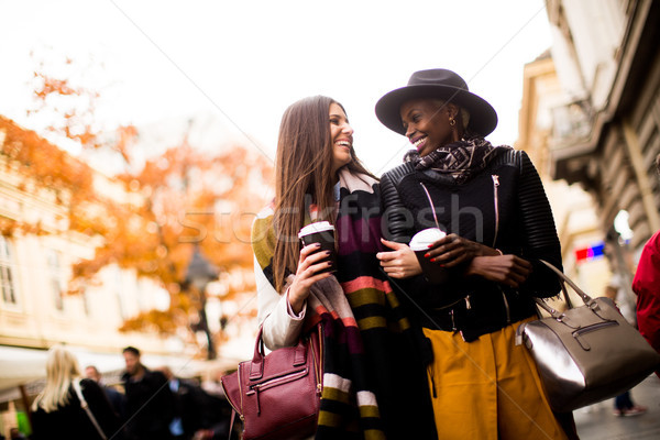 Young multiracial friends walking around the town, talking and c Stock photo © boggy