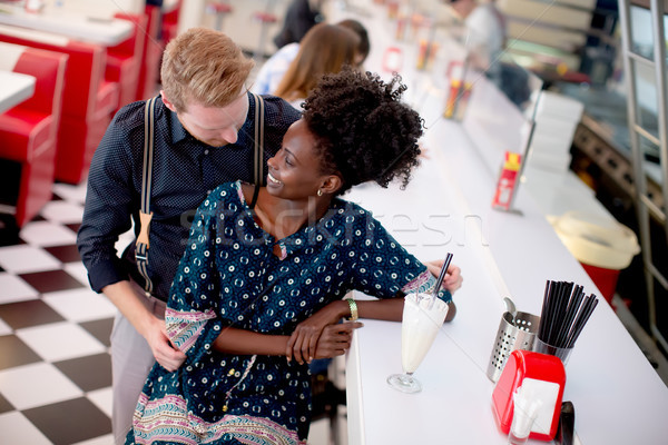 Couple hugging by the bar in the diner Stock photo © boggy