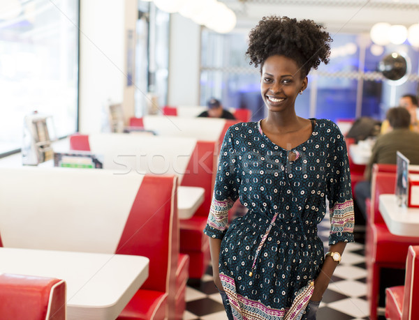 Stock photo: Young black woman in the diner