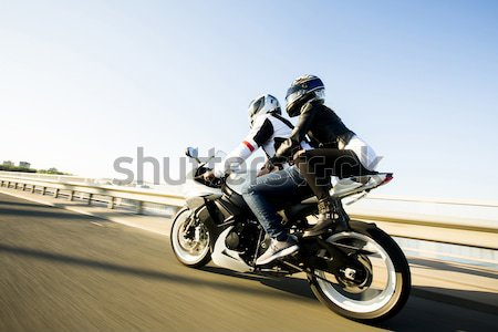 Man and woman wearing leather jackets and stylish sunglasses rid Stock photo © boggy