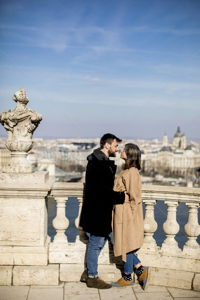 Couple in love hugging of the magnificent landscape view of Buda Stock photo © boggy