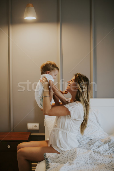 Mother and little son having fun in the bed Stock photo © boggy
