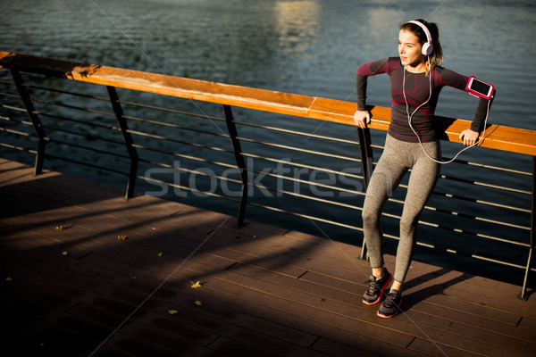 Attractive female runner taking break after jogging outdoors Stock photo © boggy
