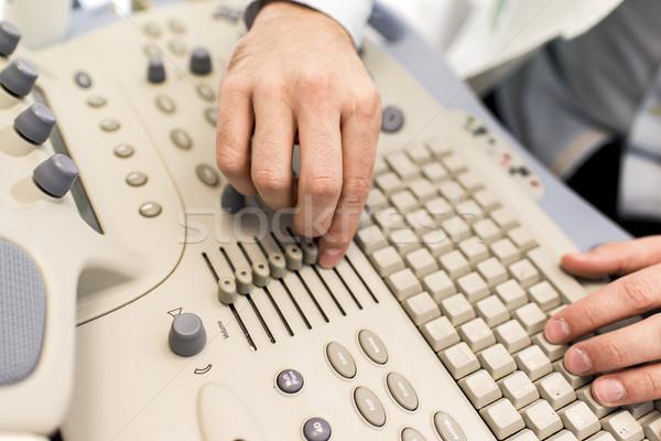 Stock photo: Doctor working on ultrasounds keyboard