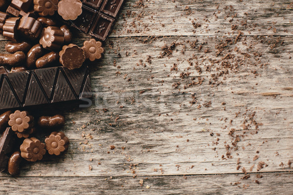 Chocolate and praline on a wooden base Stock photo © boggy