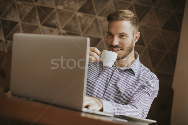 Young man drinking coffee Stock photo © boggy