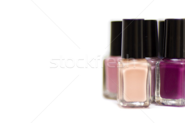 Coloured nail polish bottles a white background Stock photo © boggy