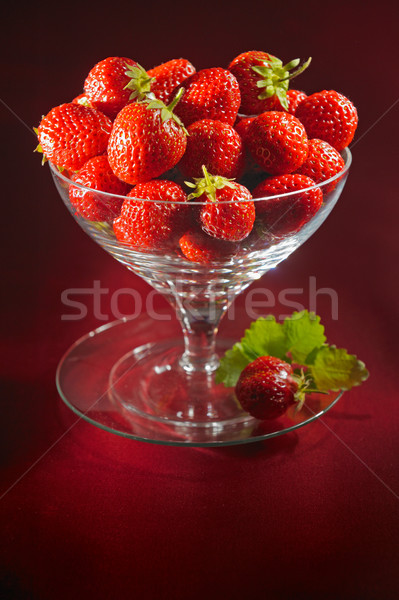A cup of fresh strawberries Stock photo © bogumil
