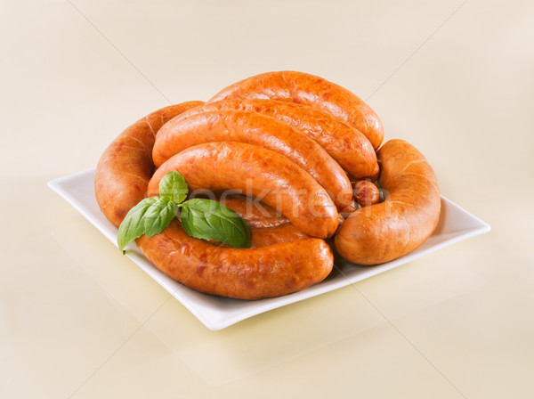 Fresh raw sausage on a plate Stock photo © bogumil