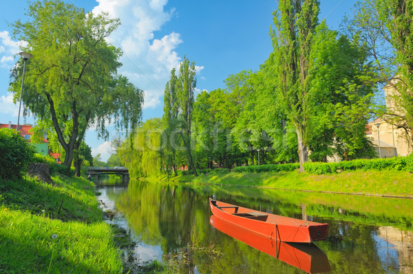 Spring landscape with boat on the Narew river. Pułtusk, Poland. Stock photo © bogumil