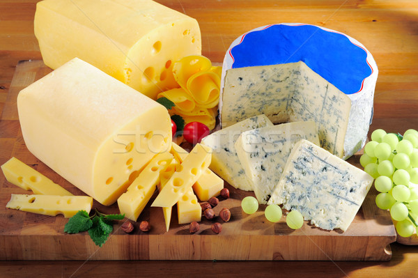 Various types of cheese on cutting board Stock photo © bogumil