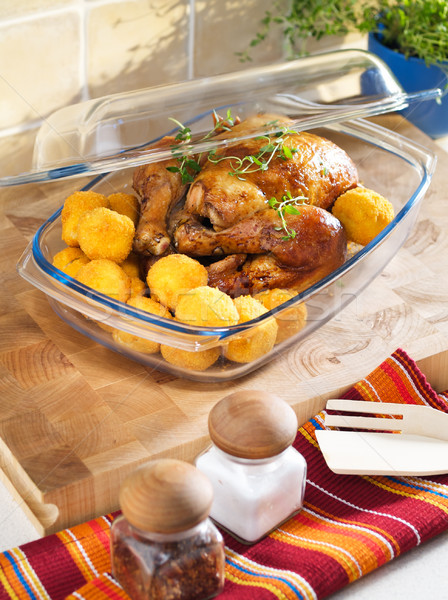 Roasted chicken in the heatproof bowl. Stock photo © bogumil