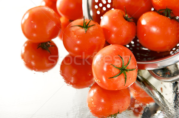 Fresh tomatoes on the mirror with strainer Stock photo © bogumil