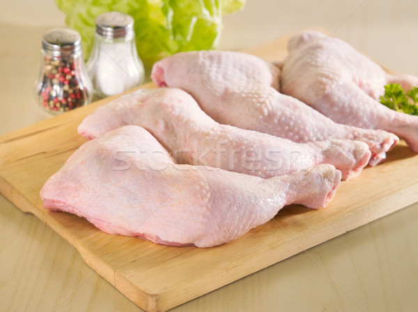 Fresh raw chicken legs arrangement on kitchen board Stock photo © bogumil