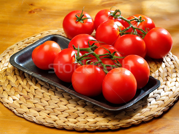 The bunch of  tomatoes on a table Stock photo © bogumil