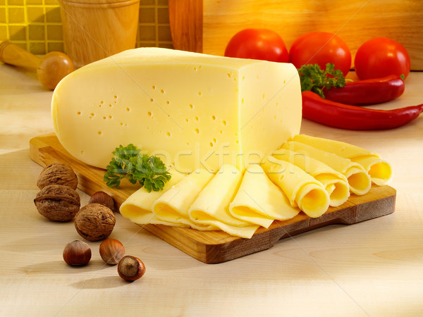 Ararangement with appetizing cheese on the kitchen table. Stock photo © bogumil