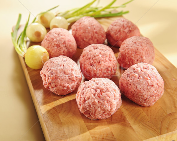 Minced delicatessen meat. Arrangement on a cutting board. Stock photo © bogumil