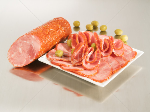Arrangement with fresh Dry Crakow Sausage on a steel silver boar Stock photo © bogumil