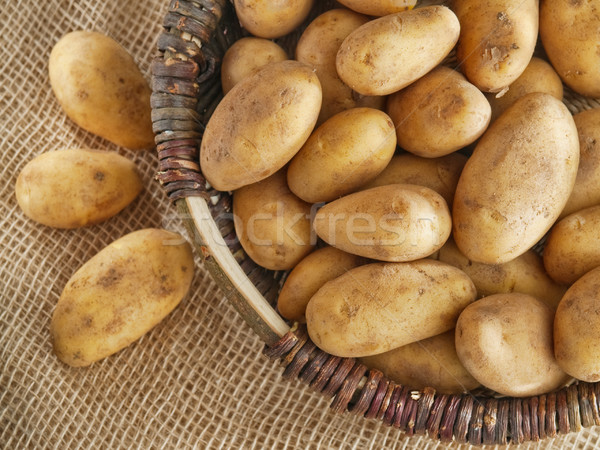 Basket of potatoes placed on the sack Stock photo © bogumil