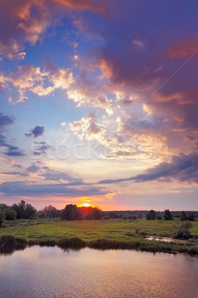 Bella sunrise romantica nubi cielo alluvione Foto d'archivio © bogumil