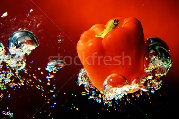 red sweet pepper in water, sweet paprika Stock photo © bogumil