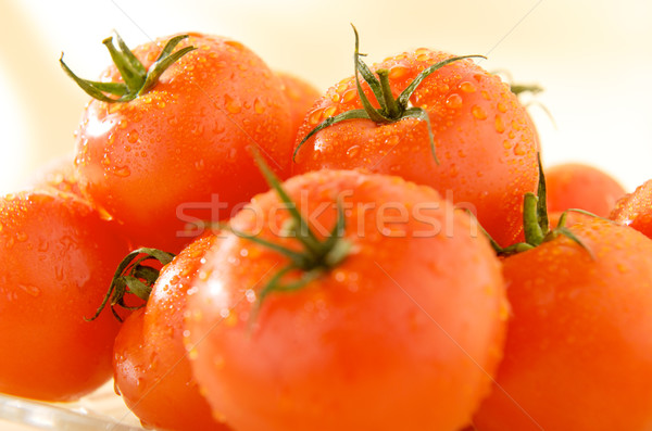 group of ripe tomatoes on yellow background Stock photo © bogumil