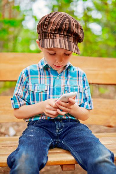 Internet telefon gülümseme çocuk teknoloji Stok fotoğraf © bogumil