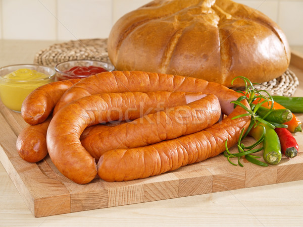 Fresh sausage on a cutting board with bread Stock photo © bogumil