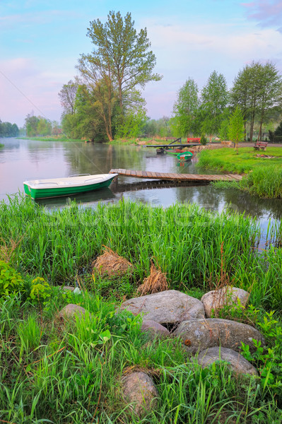 Rural landscape with boat and footbridge on the Narew river. Stock photo © bogumil