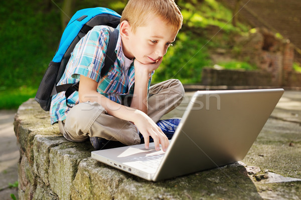 Boy delighted with laptop Stock photo © bogumil
