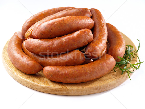 Sausages on round kitchen cutting board Stock photo © bogumil