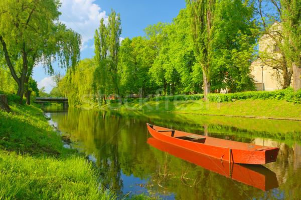 Printemps paysage bateau rivière ciel eau Photo stock © bogumil