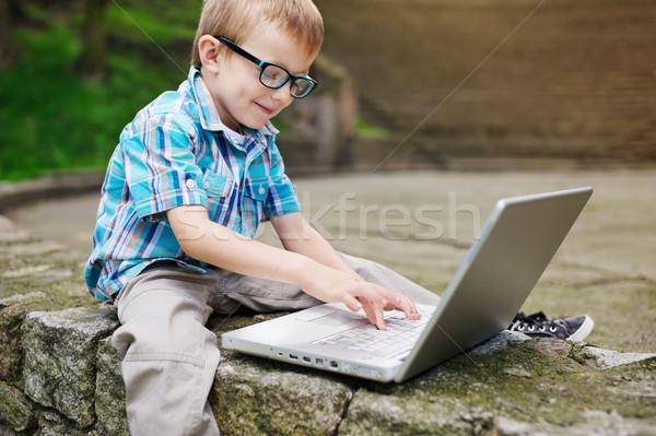 Dizüstü bilgisayar gülümseme kitap yüz okul Stok fotoğraf © bogumil