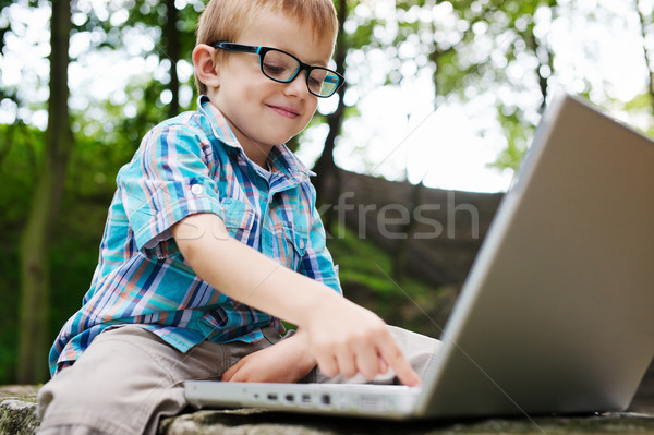 Stock photo: Boy with noteebook