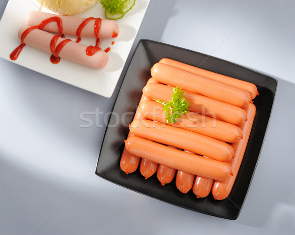 Many wiener sausages on a plate. Stock photo © bogumil
