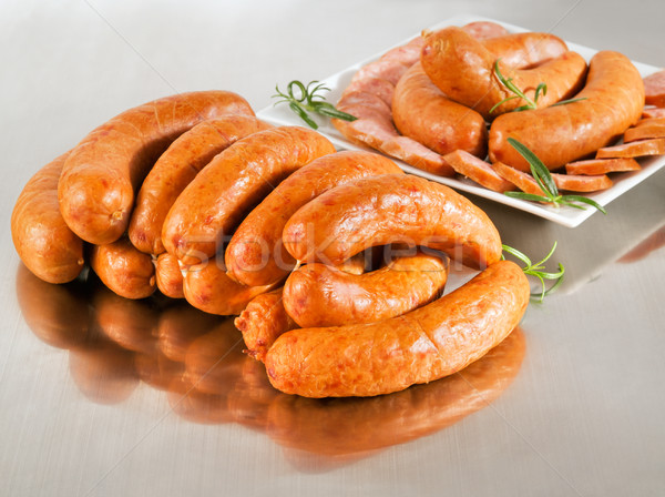 Arrangement with fresh pork sausage on a steel silver board. Stock photo © bogumil