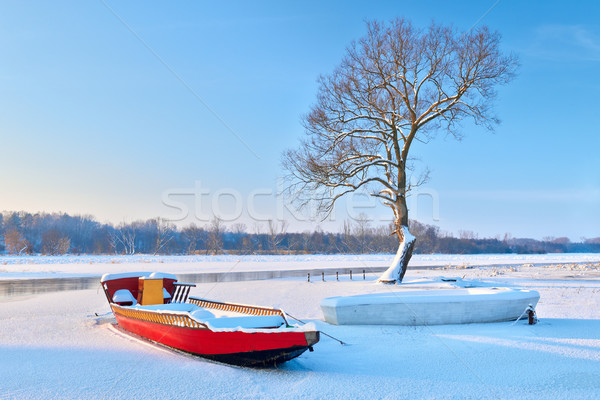 Boats on the frozen river. Stock photo © bogumil