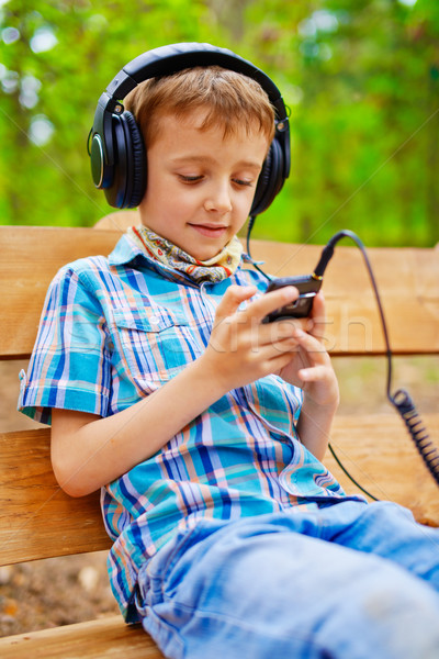 Happy kid listening to music on stereo headphones Stock photo © bogumil