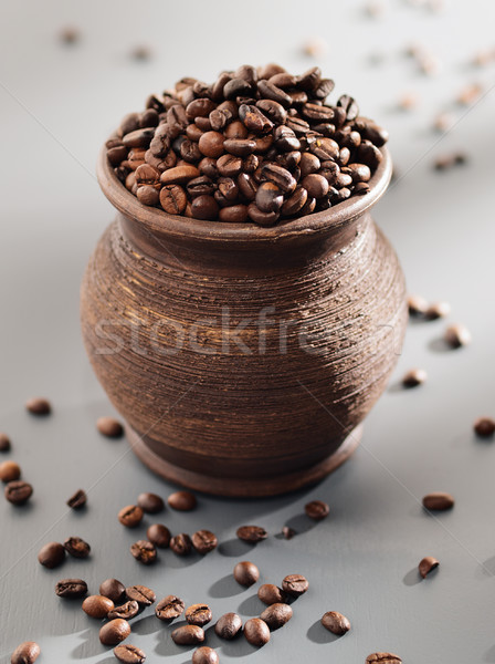 Old grungy pot full of roasted coffee beans. Stock photo © bogumil