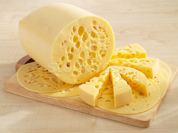 Stock photo: Beautiful yellow cheese on kitchen board