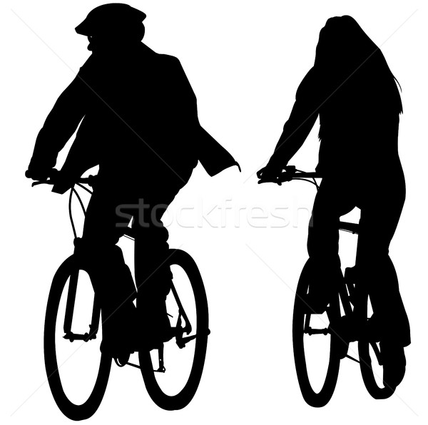 young cuople riding bicycles silhouettes Stock photo © bokica