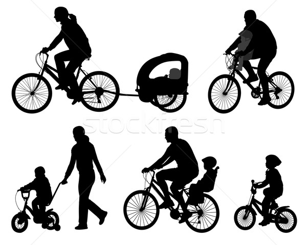 Stock photo: parents riding bicycles with their kids silhouettes