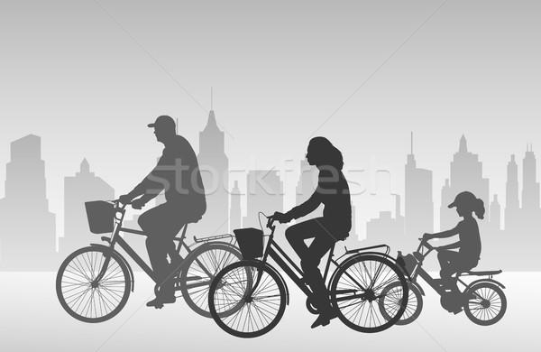 Familie paardrijden fietsen silhouetten straat veld Stockfoto © bokica