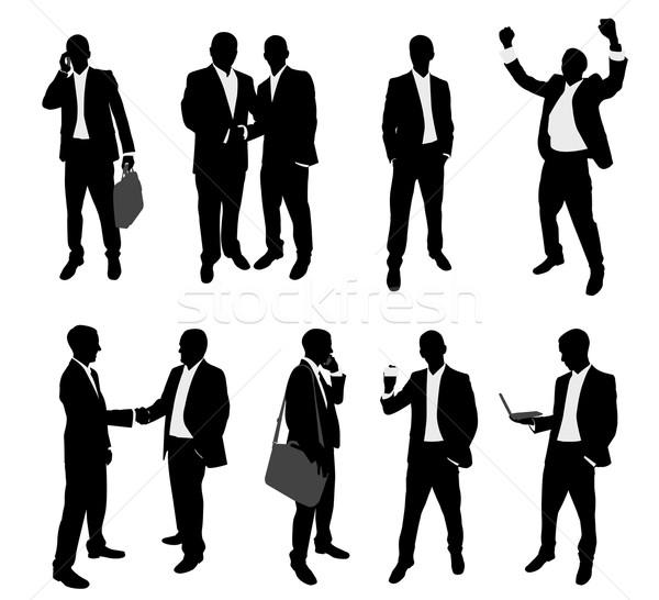 üzletemberek sziluettek üzlet kéz telefon városi Stock fotó © bokica