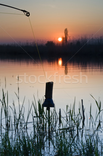Rio pescaria morder alarme pôr do sol Foto stock © Borissos