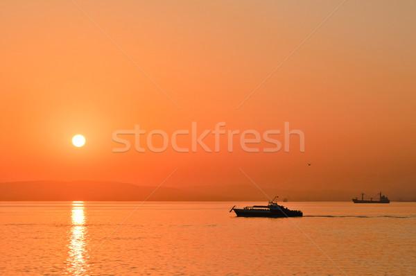 Bateaux coucher du soleil plage mer été Skyline Photo stock © Borissos