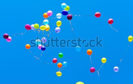 Muchos globos volar cielo cielo azul fiesta Foto stock © Borissos