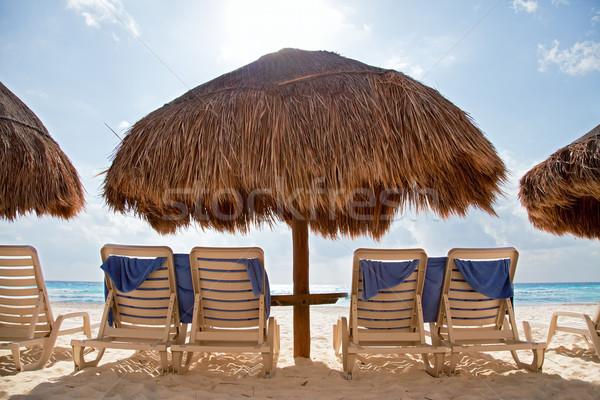 Plaj güneşlenme sandalye mavi okyanus kum Stok fotoğraf © borna_mir