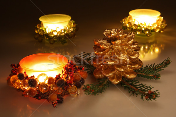 Christmas candles and golden pine cone Stock photo © borna_mir